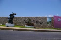 Isla Mujeres sign on a wall.jpg