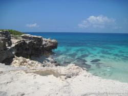 Jagged rocks and turquoise water looking out from the Isla Mujeres eastern end.jpg