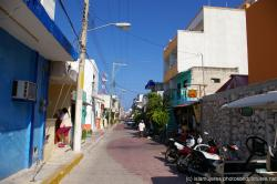 Looking down a street in El Centro in Isla Mujeres.jpg