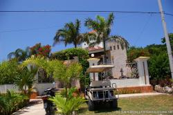 Nice home on Isla Mujeres with golf cart park out front.jpg