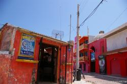 Red and pink buildings and shops in Isla Mujeres.jpg
