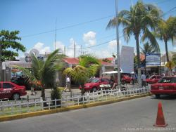 Taxis and golf cart in downtown Isla Mujeres.jpg