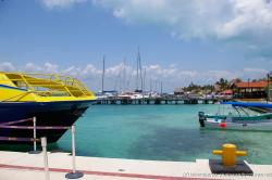 Ultramar boat and yachts docked at Isla Mujeres marina harbor.jpg