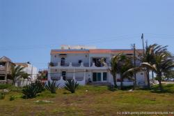 White 2 story home in Isla Mujeres.jpg