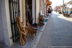 Wood carvings outside a shop in Isla Mujeres.jpg