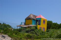 Yellow blue and pink house in Isla Mujeres.jpg