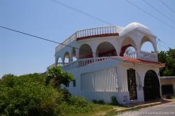 2 story white home on the eastern portion of Isla Mujeres island.jpg