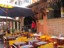 Dining tables outside a restaurant in Isla Mujeres.jpg