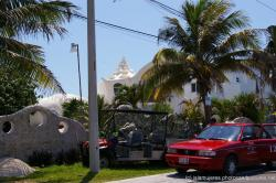Funky white home with conch shell like roof near Punta Sur Isla Mujeres.jpg