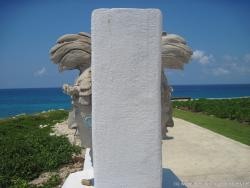 Mayan face carving on either side of a stone railing at Punta Sur Isla Mujeres.jpg