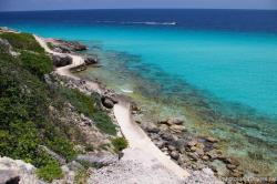 View from Punta Sur cliff of different shades of ocean water along a walk path at Isla Mujeres.jpg