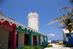 White lighthouse and shops at Punta Sur Isla Mujeres.jpg