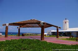 Wooden pavillion and white lighthouse at Isla Mujeres Punta Sur.jpg