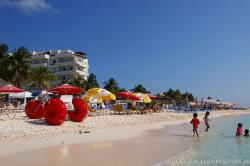 Kids play in the waters at Playa Norte Isla Mujeres.jpg
