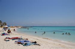 People play in the waters of Playa Norte Isla Mujeres.jpg